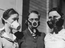 Young women model masks worn during America's Dust Bowl disaster, circa 1935.